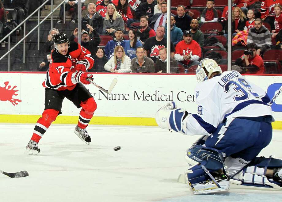 NEWARK, NJ - FEBRUARY 07:  Ilya Kovalchuk #17 of the New Jersey Devils fires the puck for a second period shorthanded goal against Anders Lindback #39 of the Tampa Bay Lightning at the Prudential Center on February 7, 2013 in Newark, New Jersey.  (Photo by Jim McIsaac/Getty Images) Photo: Jim McIsaac