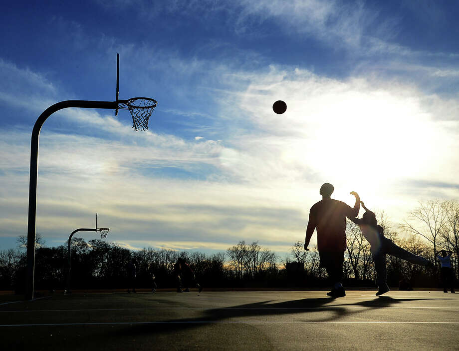 Deonte Williams, 13, and Ronald Smith, 10, play basketball as the sun sets in Greenwood Park in Birmingham, Ala., Wednesday, Feb. 6, 2013. (AP Photo/The Birmingham News, Mark Almond) MAGS OUT Photo: Mark Almond, MBI / AL.com