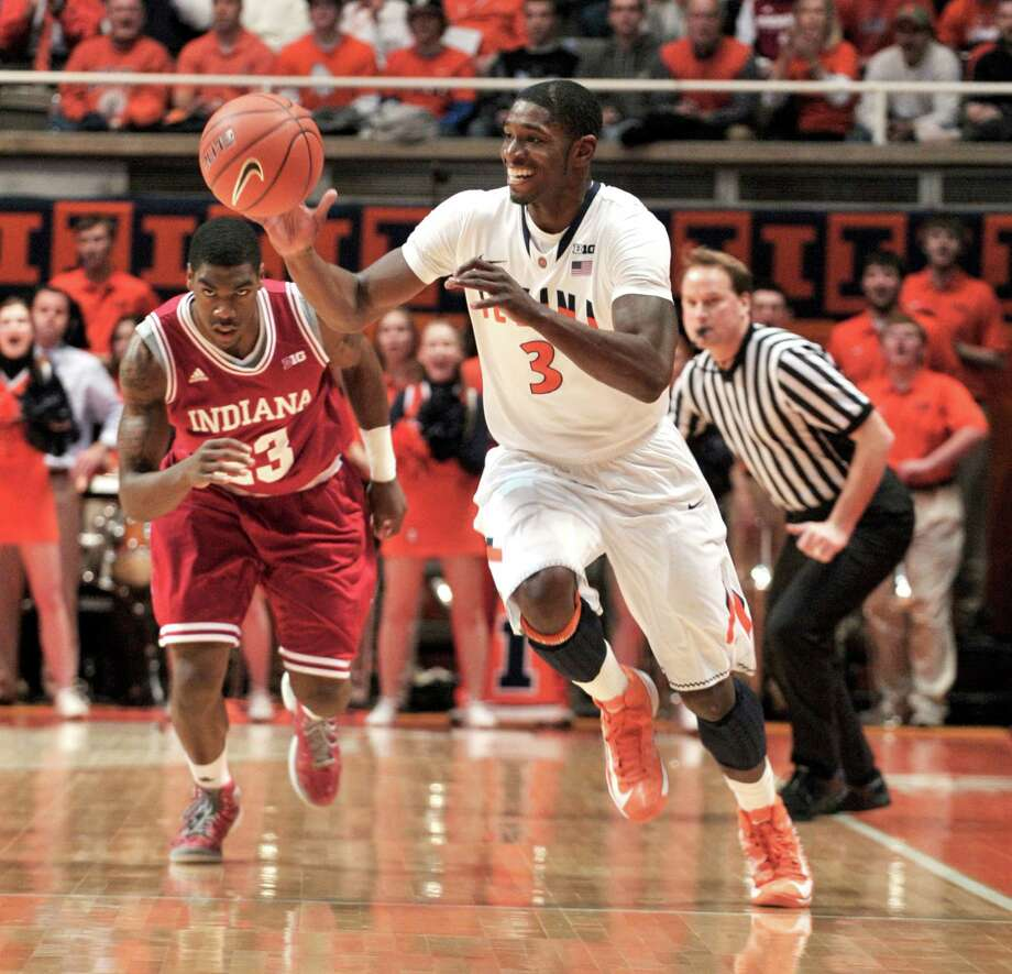 Illinois' Brandon Paul (3) steals the ball in front of Indiana's Remy Abell (23) during the first half of an NCAA college basketball game at Assembly Hall in Champaign, Ill., on Thursday, Feb. 7, 2013. (AP Photo/John Dixon) Photo: JOHN DIXON