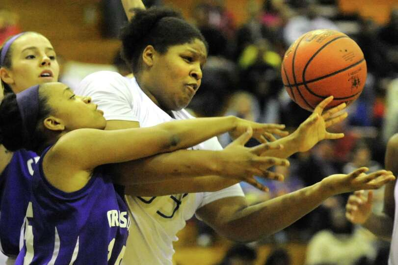Albany's Melissa Canty (33), right, and Catholic Central's Alliyah Gillespie (15) battle for a rebou