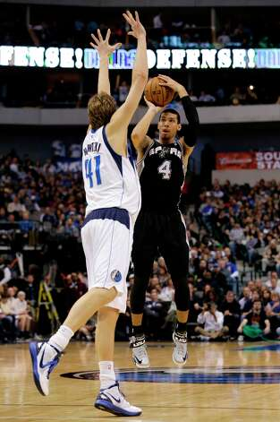 Dallas Mavericks' Dirk Nowitzki (41) of Germany defends as San Antonio Spurs' Danny Green (4) attempts a three-poing basket in the second half of an NBA basketball game Friday, Jan. 25, 2013, in Dallas. The Spurs won 113-107. Photo: Tony Gutierrez, Associated Press / AP