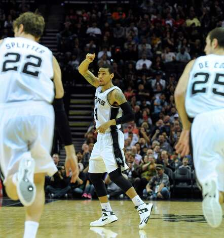 Danny Green of the San Antonio Spurs gestures after scoring on a three-point shot against the Houston Rockets at the AT&T Center on Friday, Dec. 7, 2012. Photo: Billy Calzada, San Antonio Express-News / SAN ANTONIO EXPRESS-NEWS
