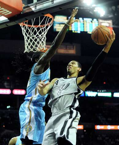 Danny Green of the Spurs, right, shoots as Kenneth Faried of the Denver Nuggets attempts to block his shot in the Alamodome on Nov. 17, 2012. Photo: Billy Calzada, San Antonio Express-News / SAN ANTONIO EXPRESS-NEWS