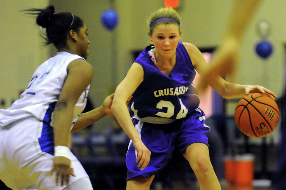 Catholic Central's Madison Purcell (24), right, controls the ball as Albany's India Terrell (22) defends during their basketball game on Thursday, Feb. 7, 2013, at Albany High in Albany, N.Y. (Cindy Schultz / Times Union) Photo: Cindy Schultz / 10021070A