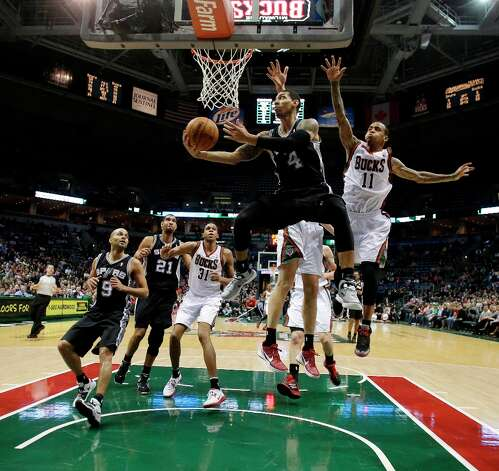 San Antonio Spurs' Danny Green (4) shoots against Milwaukee Bucks' Monta Ellis (11) during the second half of an NBA basketball game on Wednesday, Jan. 2, 2013, in Milwaukee. Photo: Morry Gash, Associated Press / AP