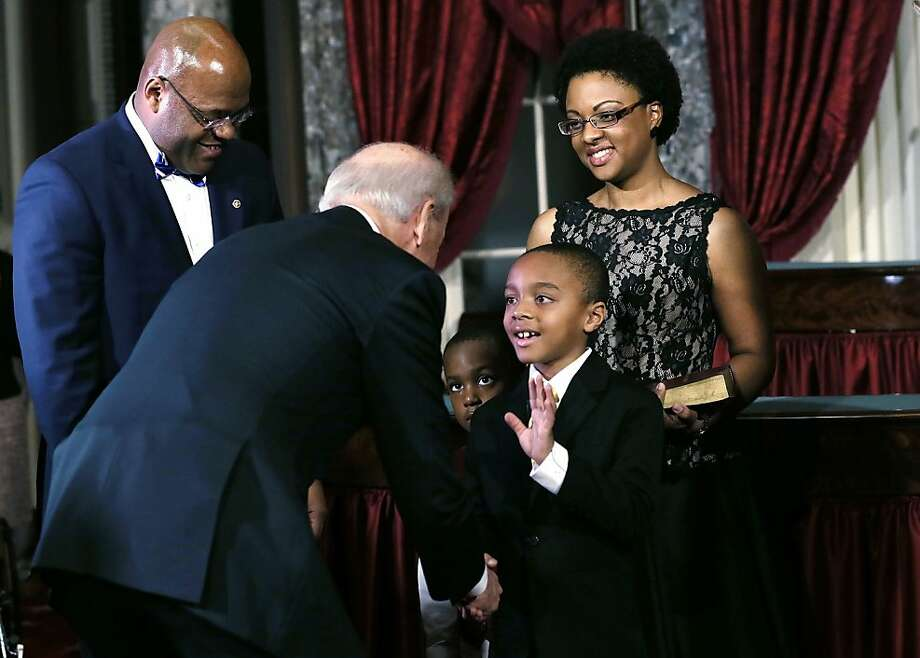 "Miles Cowan (4th L), son of U.S. Sen. William ""Mo"" Cowan (D-MA) (L), greets U.S. Vice President Joseph Biden (2nd L) as his mother Stacy (R), and brother Grant (3rd L) look on during his father's re-enacted swearing-in February 7, 2013 at the Old Senate Chamber of the U.S. Capitol in Washington, DC. Cowan was appointed by Massachusetts Governor Deval Patrick as interim U.S. Senator to fill the seat that left vacant by Secretary of State and former Senator John Kerry.  Photo: Alex Wong, Getty Images"