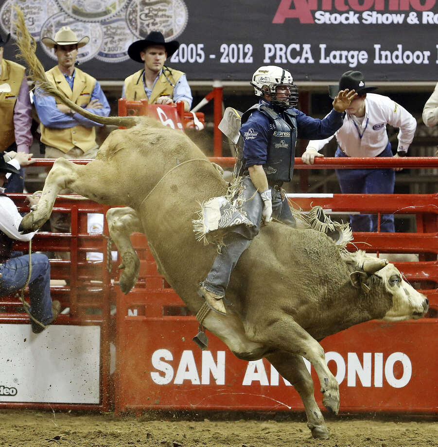Corey Navarre of Weatherford, Okla., competes in bull riding during the San Antonio Stock Show & Rodeo's opening night. He was thrown off his bull, but he'll return tonight and Saturday. He came into the night ranked eighth in the world standings. Photo: Edward A. Ornelas / San Antonio Express-News