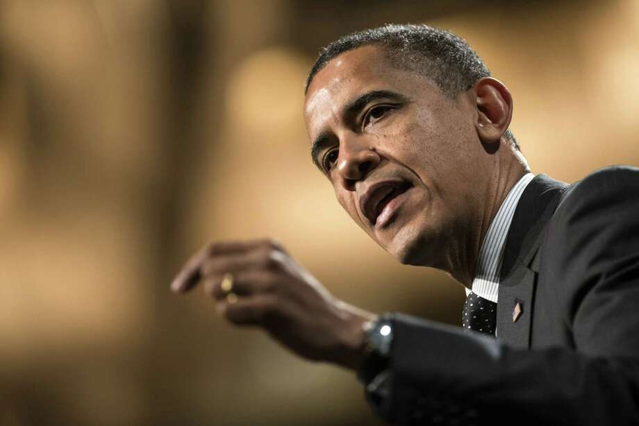 President Barack Obama urged House Democrats to keep in mind why they got into public service. Then he told them it was to improve their communities. Photo: Brendan Smialowski / Getty Images