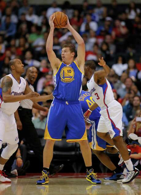 David Lee has helped the 30-19 Warriors elevate their game this season. Photo: Jae Hong, STF / AP2012