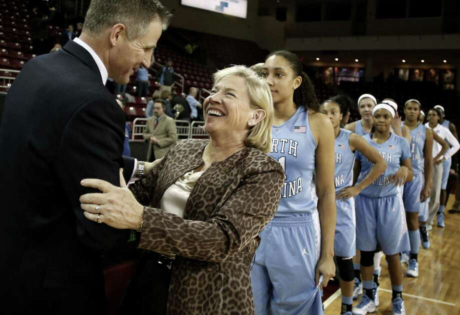 North Carolina coach Sylvia Hatchell is greeted by Boston College's Erik Johnson after recording her 900th career win. Photo: Winslow Townson / Associated Press