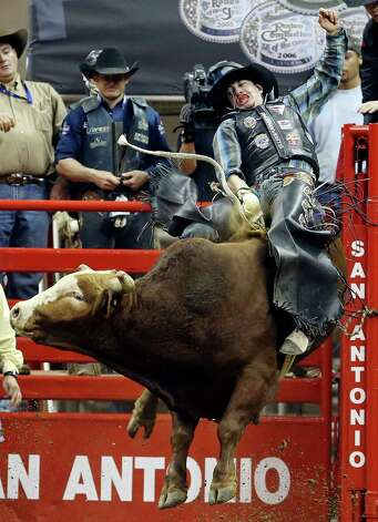 Cody Samora, of Cortez, CO, competes in the bull riding event during the San Antonio Stock Show & Rodeo Thursday Feb. 7, 2013 at the AT&T Center.   Samora was thrown off his bull. Photo: Edward A. Ornelas, San Antonio Express-News / © 2013 San Antonio Express-News