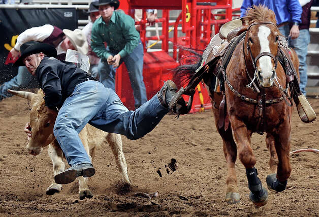 Luke Branquinho, of Los Alamos, Calif., misses his steer in the steer wrestling event during the San Antonio Stock Show & Rodeo Thursday Feb. 7, 2013 at the AT&T Center. Photo: Edward A. Ornelas, San Antonio Express-News / © 2013 San Antonio Express-News