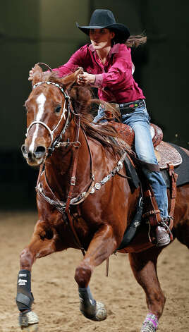 Sydni Blanchard, of Albuquerque, N.M., competes in the barrel racing event during the San Antonio Stock Show & Rodeo Thursday Feb. 7, 2013 at the AT&T Center. Blanchard's time was 13.90 seconds. Photo: Edward A. Ornelas, San Antonio Express-News / © 2013 San Antonio Express-News