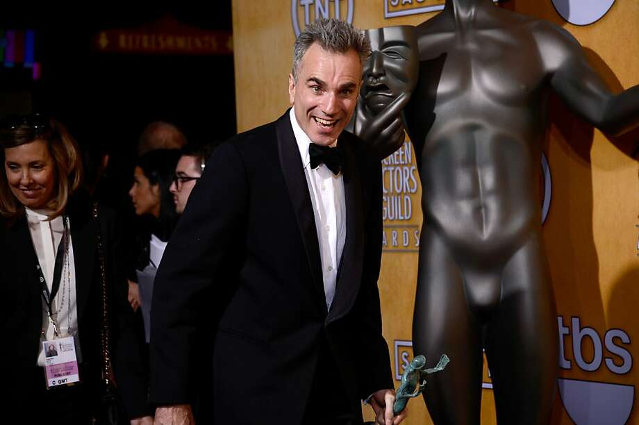 Daniel Day-Lewis, shown with the Screen Actors Guild Award he won  in January, will almost certainly add a third Oscar to his collection. Photo: Frazer Harrison, Getty Images