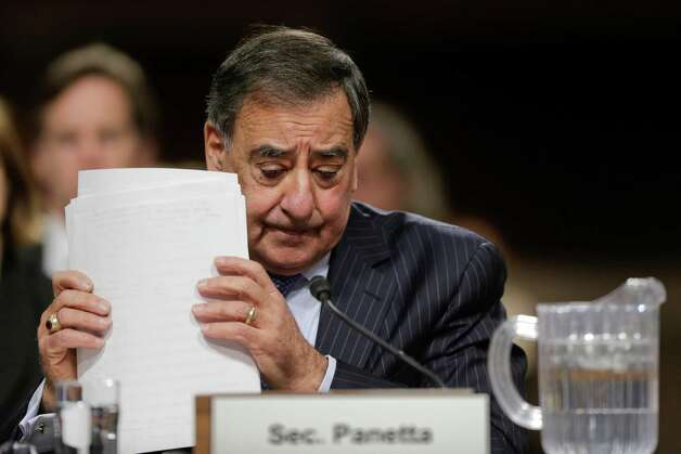 Outgoing Defense Secretary Leon Panetta adjusts his papers as he testifies on Capitol Hill in Washington, Thursday, Feb. 7, 2013, before the Senate Armed Services Committee about the Pentagon's role in responding to the attack last year on the U.S. consulate in Benghazi, Libya, where the ambassador and three other Americans were killed.  (AP Photo/J. Scott Applewhite) Photo: J. Scott Applewhite