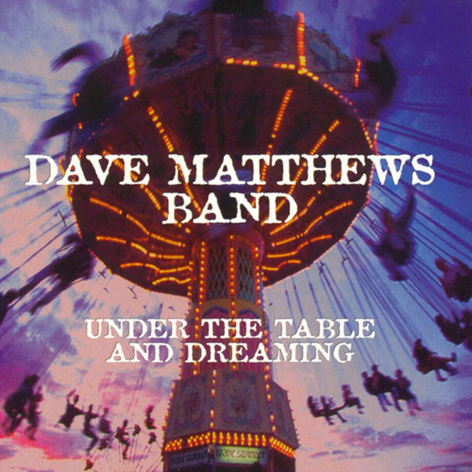 """Dave Matthews Band – """"Under the Table and Dreaming:""""One of the all-time greatest live bands, Dave Matthews Band could still pack a stadium playing just the tracks form this album. This is the disc with """"Satellite,"""" and """"Ants Marching,"""" but also has other gems including """"Warehouse,"""" """"Jimi Thing,"""" and """"The Best of What's Around."""" They had released an earlier album, """"Remember Two Things,"""" but this was their first major-label release. People who graduated high school in the 1990s will likely remember how the early disc was all black with white letters, and later pressings were multi-colored. (Album cover)"""