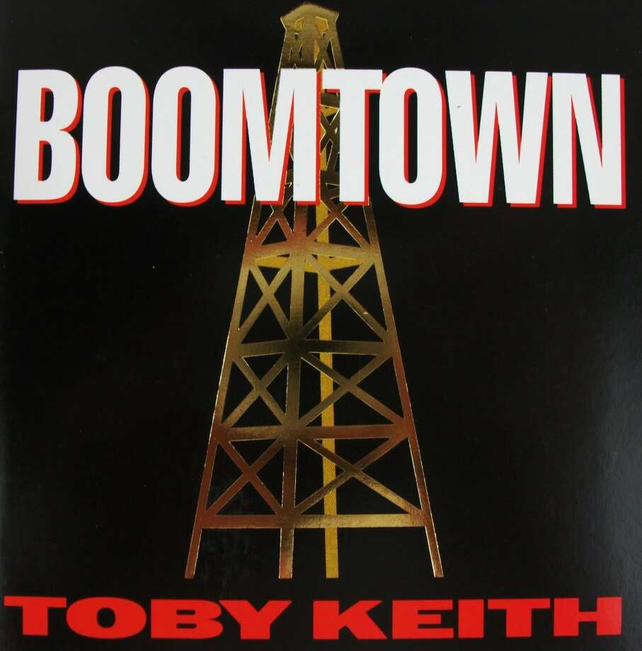 """Toby Keith – """"Boomtown:""""This 1994 release is the second album from the Ford truck-drivin', George W. Bush-supportin' singer, and includes """"Big Ol' Truck."""" It also had other hit singles: """"Who's That Man,"""" """"Upstairs Downtown,"""" and """"You Ain't Much Fun."""" (Album cover)"""
