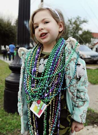 Four year old Cameron Jones, of Orange, shows off her beads along the parade route during the Courir Parade on Thursday, February 7,2013, in Port Arthur. Photo taken: Randy Edwards/The Enterprise