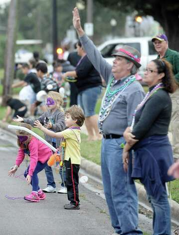 The streets are lined with families and friends along the parade route during the Courir Parade on Thursday, February 7,2013, in Port Arthur. Photo taken: Randy Edwards/The Enterprise Photo: Randy Edwards