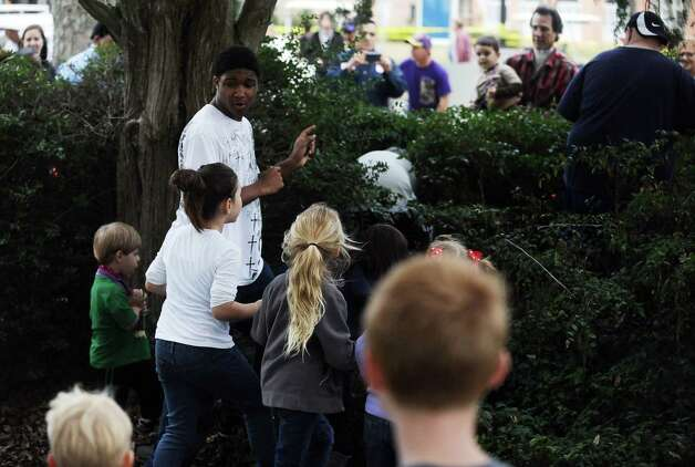 Children from all over southeast texas search for the courir parade chicken in the bushes in front of the Rose Hill Manor on Thursday, February 7,2013, in Port Arthur. Photo taken: Randy Edwards/The Enterprise Photo: Randy Edwards