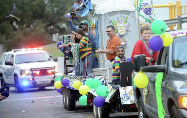 Krewe members throw beads along the parade route during the Courir Parade on Thursday, February 7,2013, in Port Arthur. Photo taken: Randy Edwards/The Enterprise Photo: Randy Edwards