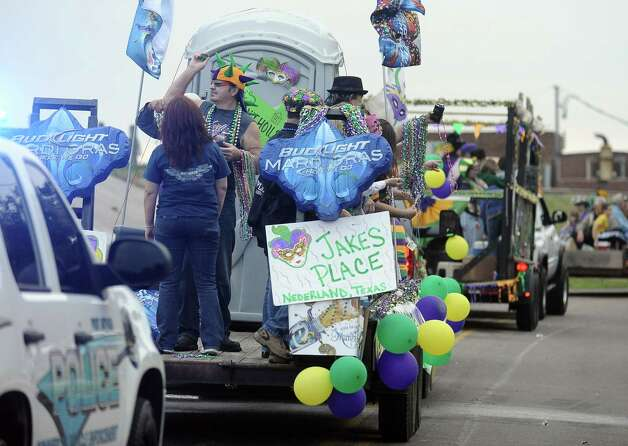 Krewe members throw beads along the parade route during the Courir Parade on Thursday, February 7,2013, in Port Arthur. Photo taken: Randy Edwards/The Enterprise