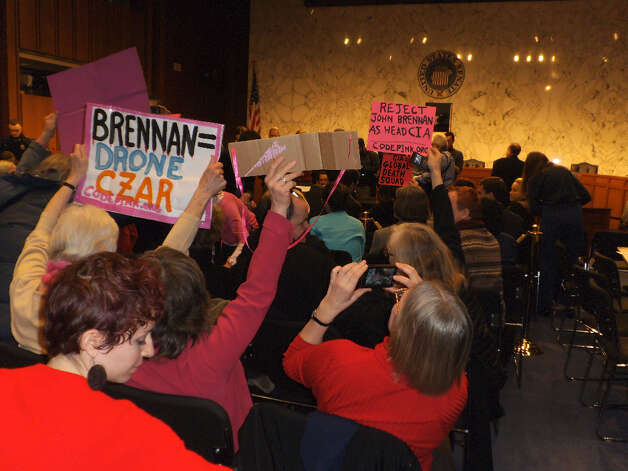 Code Pink protesters await CIA Director nominee John Brennan at a Senate Intelligence Committee hearing (photo by Corey Kane)
