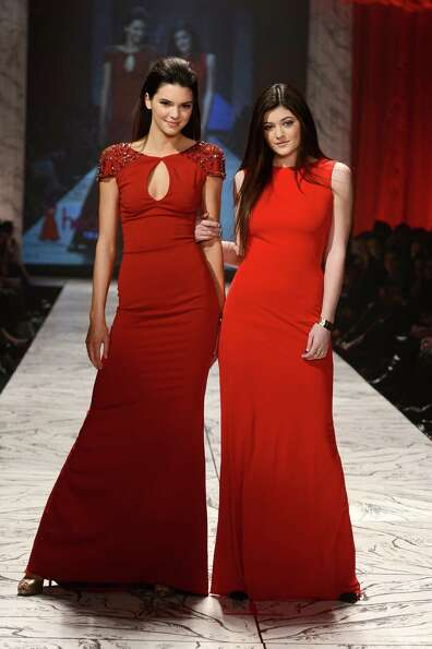 Kendall and Kylie Jenner walk the runway.