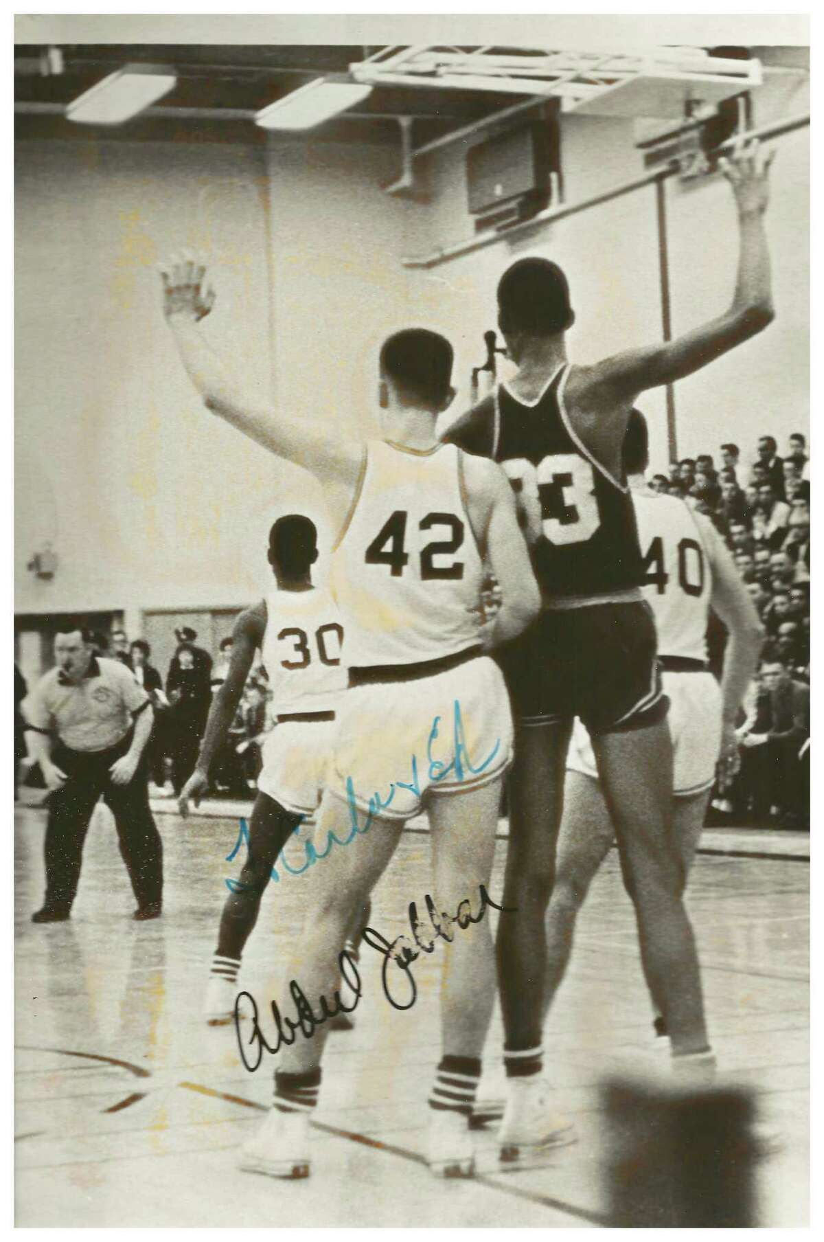 Bill Boehm, star Linton High School basketball player, guards a young Lew Alcindor (now Kareem Abdul-Jabbar) during a game in 1961 at Linton. Jabbar's autograph can be seen on the photo. Boehm's sister, Carla Boehm Sloan, who provided this photo from her family's scrapbook, sent the photo to Jabbar in recent years who authgraphed it for her.