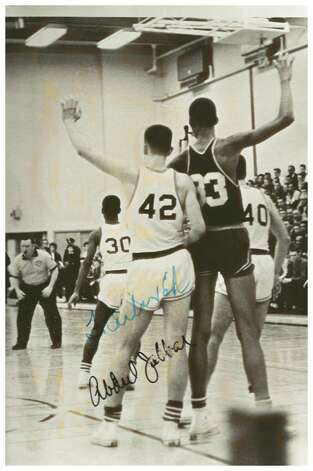 Bill Boehm, star Linton High School basketball player, guards a young Lew Alcindor (now Kareem Abdul-Jabbar) during a game in 1961 at Linton. Jabbar's autograph can be seen on the photo.  Boehm's sister, Carla Boehm Sloan, who provided this photo from her family's scrapbook, sent the photo to Jabbar in recent years who authgraphed it for her. Photo: Unknown