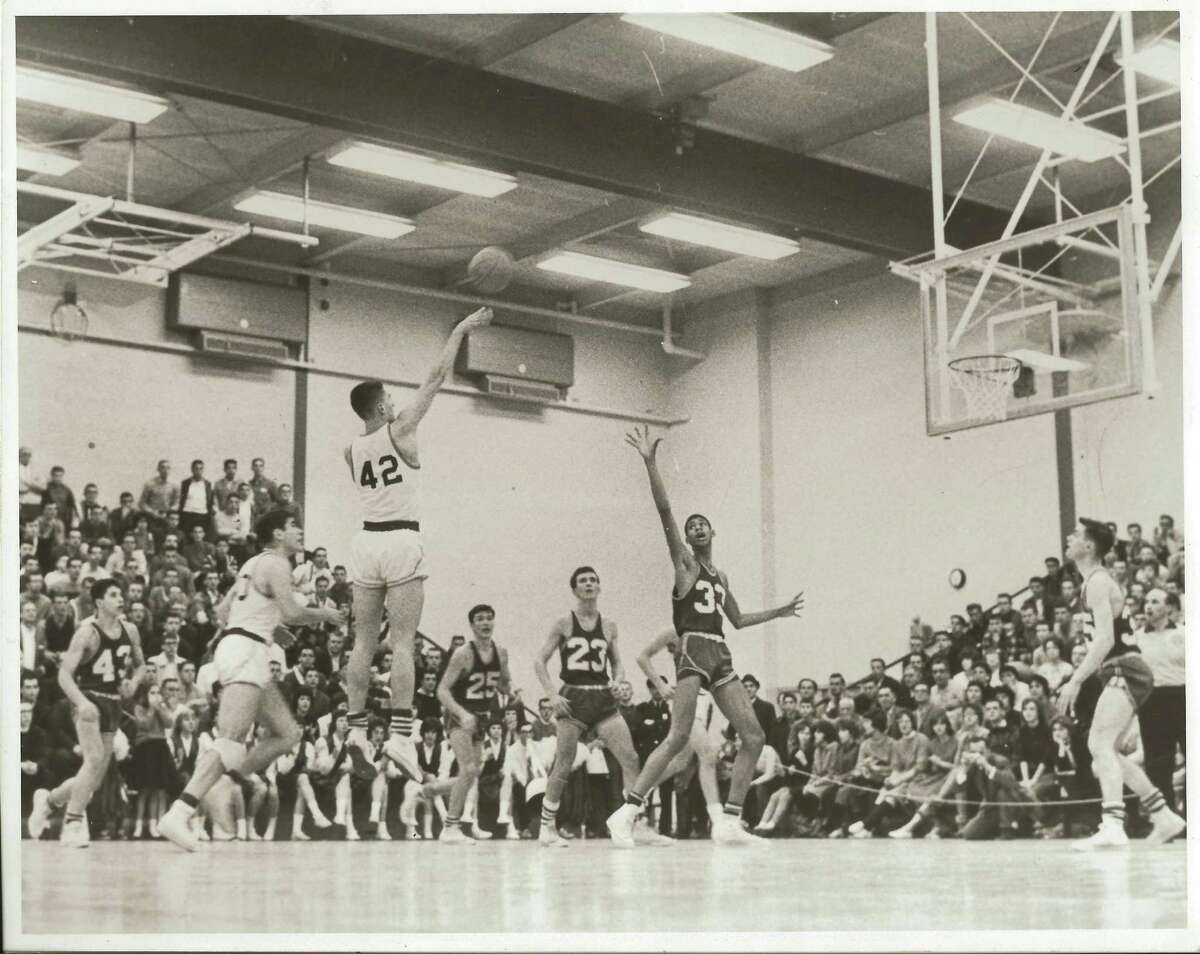Bill Boehm , star Linton High School basketball player, takes a shot as a young Lew Alcindor (now Kareem Abdul-Jabbar), number 33, raises his arm to block, during a game in 1961 at Linton. Boehm 's sister, Carla Boehm Sloan, provided this photo from her family's scrapbook.