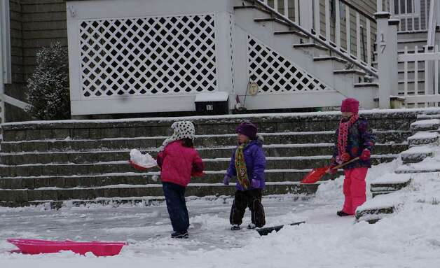 Children, whose scholol was cancelled Friday by the strom, play on Veres Street in early snowfall Friday. FAIRFIELD CITIZEN, CT 2/8/13 Photo: Genevieve Reilly / Fairfield Citizen