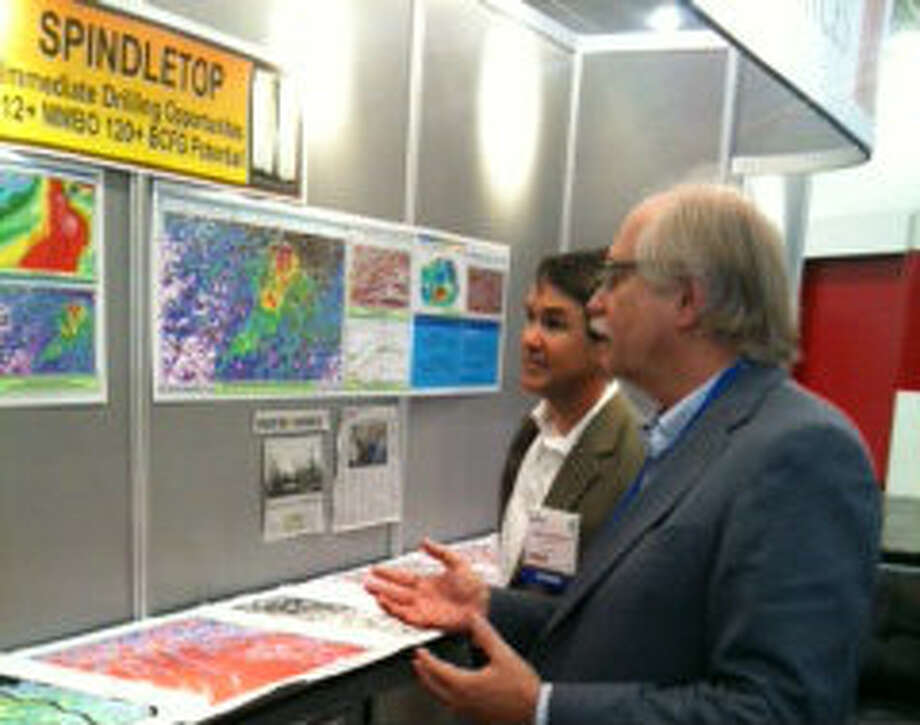 Brian Kalinec, a geophycisist on the team planning to drill for oil at Spindletop, shows a prospective investor seismic data from the historic oil field at the Winter NAPE Expo.