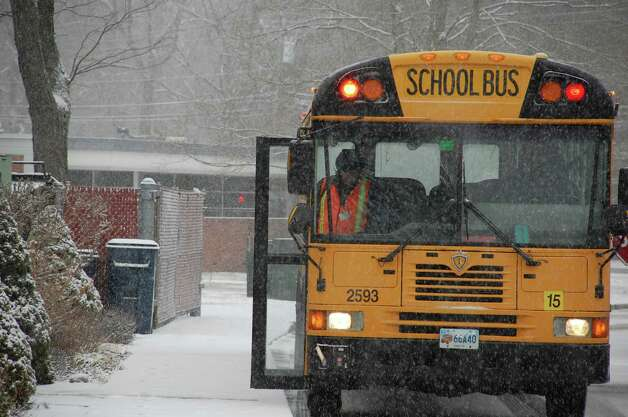 Despite  snow that began falling in Westport shortly after 7 a.m. Friday, schools were in session at Coleytown Elementary School and other local schools. But shortly after students arrived, officials called for an early dismissal. WESTPORT NEWS, CT 2/8/13 Photo: Jarret Liotta / Westport News contributed