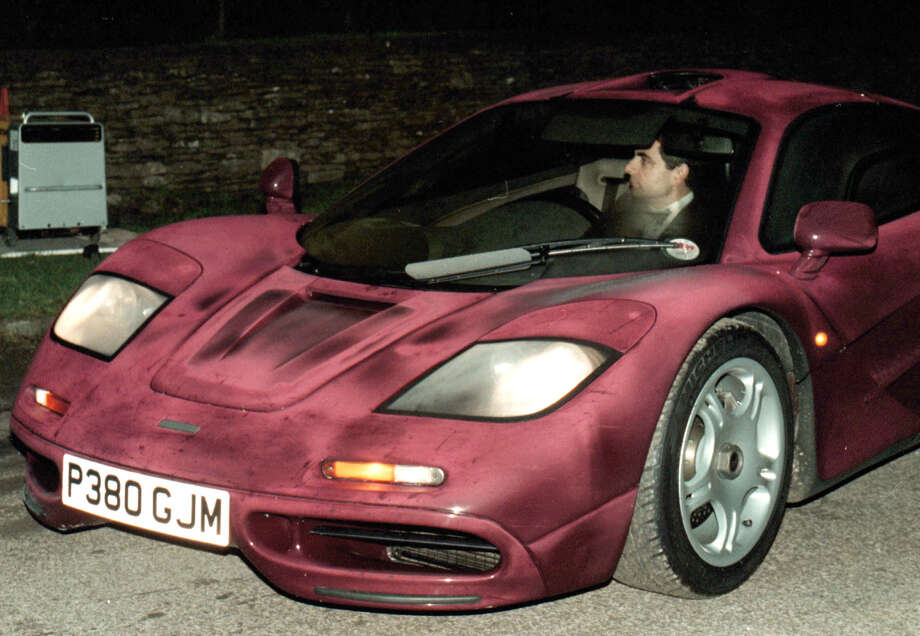 Photo dated Nov. 15 1998 of comedian Rowan Atkinson at the wheel of his McLaren F1 sports car. It was reported Friday Feb. 8 2013 that it took more than a year — and more than 900,000 pounds ($1,400,000) — to get his supercar up and running after a 2011 crash in which he badly injured a shoulder,  but F1's now sell for around 3.5 million pounds. The car makes extensive use of carbon fiber and needed specialist care. The car insurance settlement is one of the largest in British history.   UNITED KINGDOM OUT    NO ARCHIVE Photo: Barry Batchelor/PA