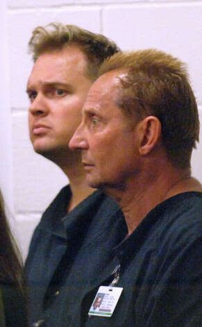 Defendants Kirk Calvert, left, and Mike Loomis appear at an extradition hearing at the Orange county jail in Orlando, Fla., Thursday, March 1, 2007. Federal and state agents raided two pharmacies in Orlando, Fla., on Tuesday in connection with an investigation in to illicit steroid distribution networks. (AP Photo/Joe Burbank, Pool) Photo: Joe Burbank / POOL ORLANDO SENTINEL