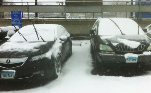 Wiper blades upto avoid freezing, a common scene at the commuter parking lot of the Fairfield Railroad Station in the face of an oncoming blizzard Friday.  FAIRFIELD CITIZEN, CT 2/8/13 Photo: John Schwing / Fairfield Citizen contributed
