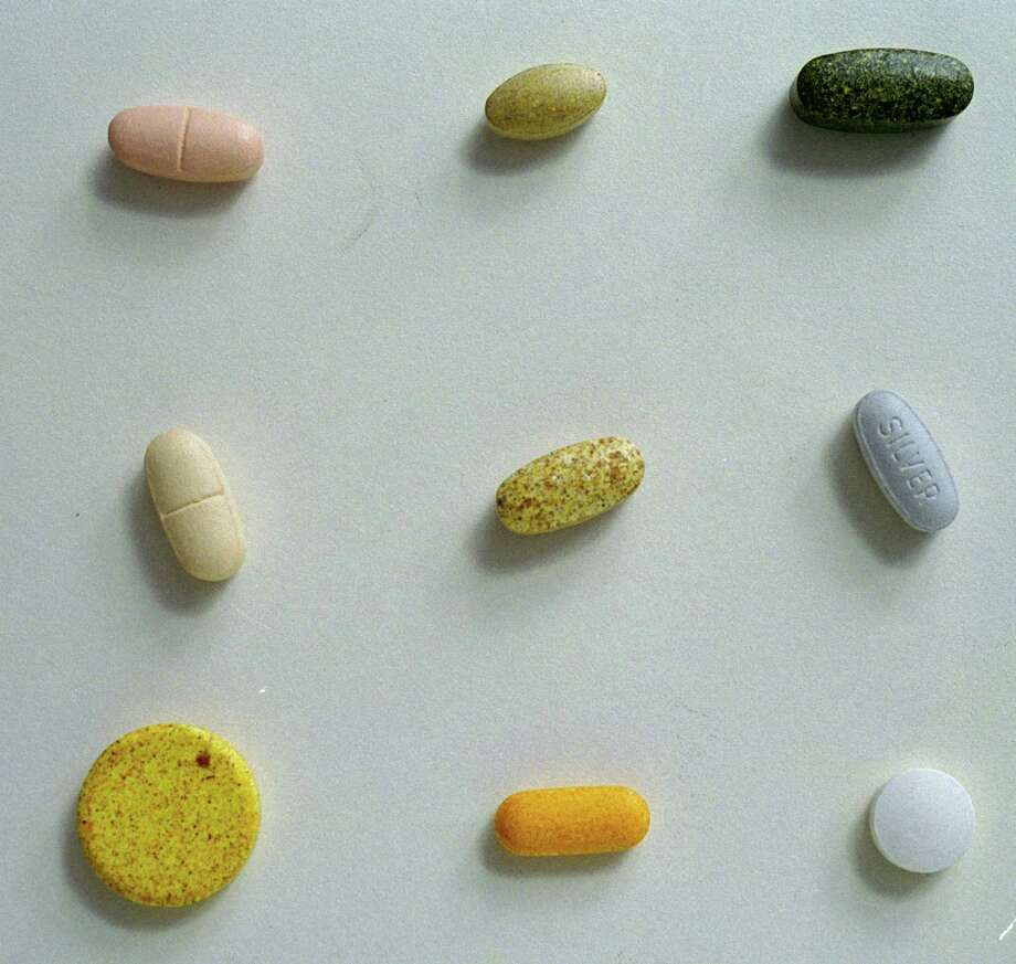 CONTACT FILED:  VITAMINS A group of vitamins was photographed in studio, 8/20/02, for an illustration. (Buster Dean / Chronicle)  HOUCHRON CAPTION (10/21/2002):  Multivitamins may help prevent chronic illnesses such as heart disease. - Scientists suggest all adults take vitamin supplements. - The elderly may be a target for taking multivitamins. - But labels on multivitamins currently don't help clear the mystery. - The body can't make 40 vitamins and minerals it needs. - Many multivitamins fail to meet quality standards, - Multivitamins are not magic bullets. - Take a vitamin; eat a balanced diet. - Vitamins are not regulated for safety. Photo: Buster Dean, Staff / Houston Chronicle