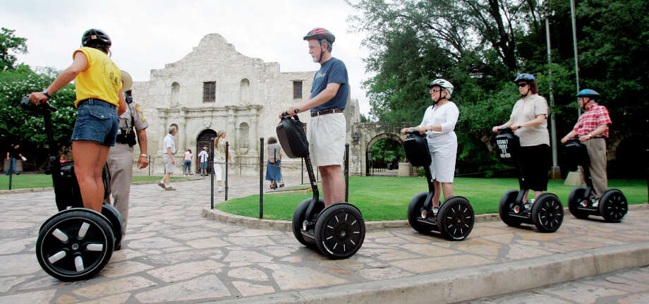 10. SEGWAY TOURS: You'll look like dorks, but you'll look like dorks together. Awwwww!!! Photo: Eric Gay, AP / AP