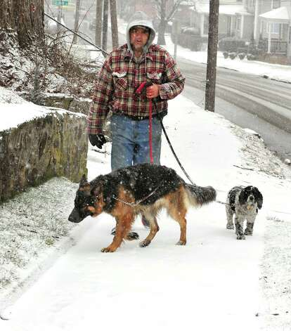 "Snow or no the dogs still have to be walked .""It's fun"" Dave Reinhardt said, in Danbury Friday Feb. 8, 2013. Photo: Michael Duffy / The News-Times"