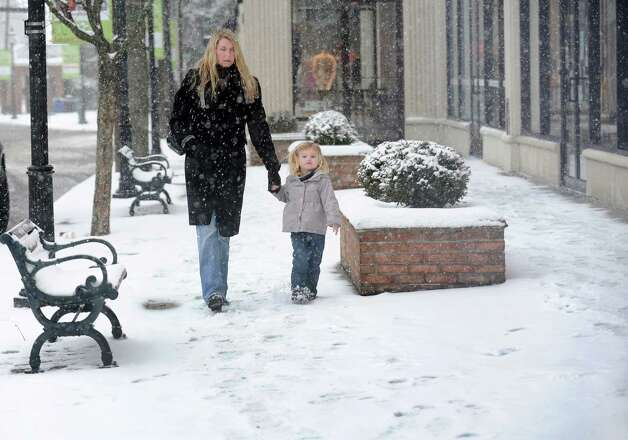 While they could still get out of the house, Sarah McAleer and two year-old Kendall McAleer head to the Fairfield University Bookstore in downtown Fairfield, Conn. on Friday, Feb. 8, 2013. They may be forced to stay indoors later today as the forecast predicts southern Fairfield County could get 10 to 14 inches of snow by time the storm passes sometime overnight. Photo: Cathy Zuraw / Connecticut Post