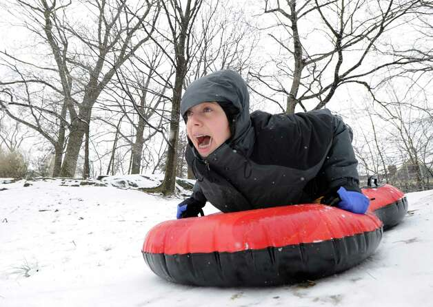 Enjoying her day off from school, Lydia Perling, 11, screams a she goes down head-first on her sled on the hill behind the Byram Shubert Library during the snowstorm that hit the Byram section of Greenwich, Conn., Friday, Feb. 8, 2013. Photo: Bob Luckey / Greenwich Time