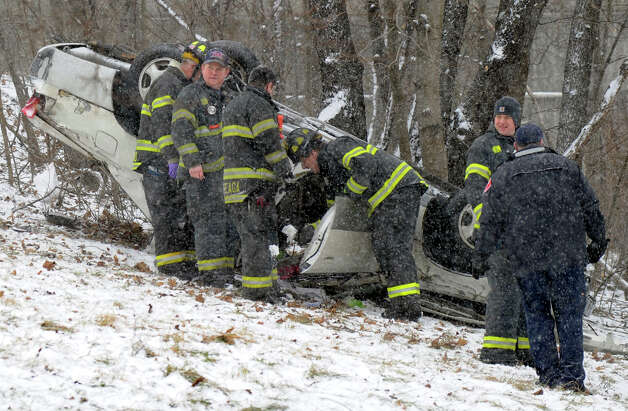A one-car accident off of I-84 West, near the Exit 6 ramp in Danbury, Conn. sent one person to the hospital Friday morning and backed up traffic on the highway around 11:30 a.m. Friday, Feb. 8, 2013. The snow started later than expected in the Danbury area Friday morning but the roads became slick quickly. Photo: Carol Kaliff / The News-Times