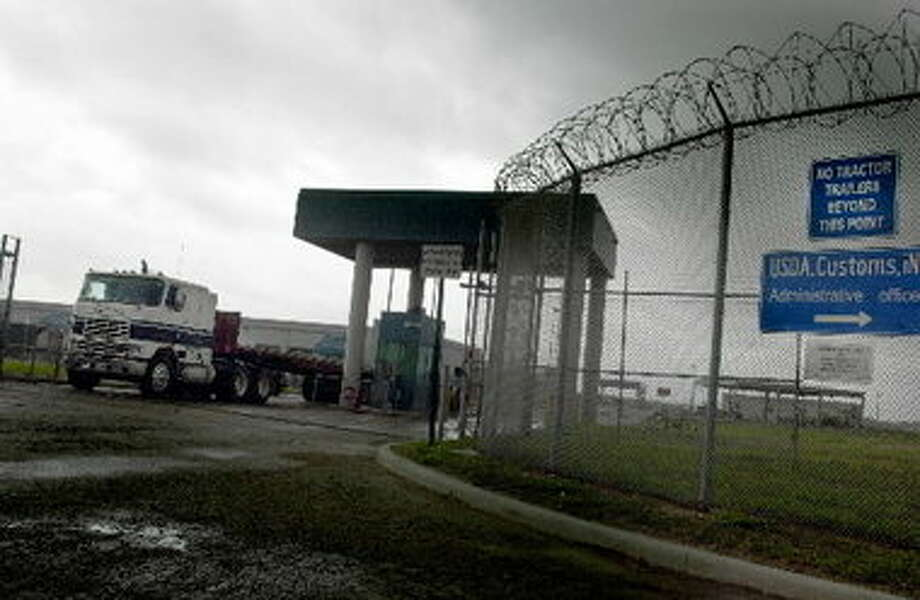 Associated Press; A truck passes through a border check point into Texas