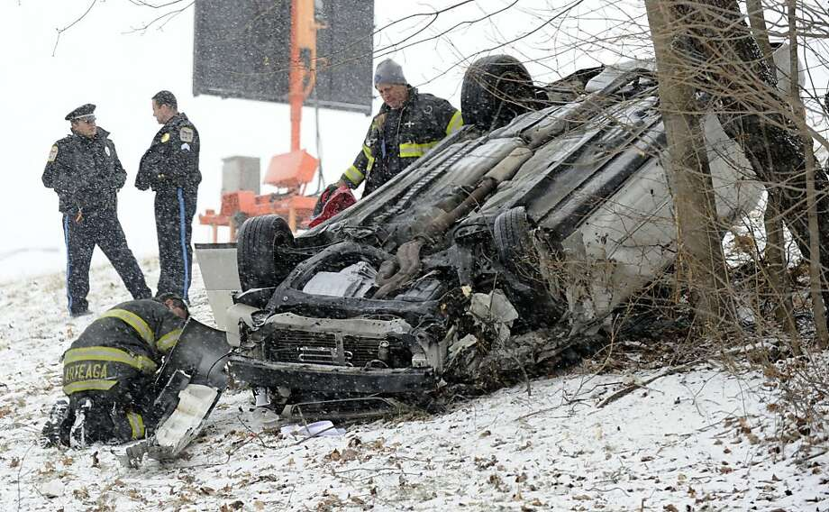 A one-car accident off of I-84 West, near the Exit 6 ramp in Danbury, Conn. sent one person to the hospital Friday morning and backed up traffic on the highway around 11:30 a.m. Friday,  Feb. 8, 2013. The snow started later than expected in the Danbury area Friday morning but the roads became slick quickly. Photo: Carol Kaliff