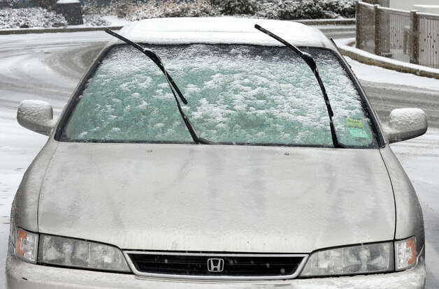 A driver leaves the windshield wipers in the upright position to make it easier to remove snow later at the start of a major snow storm hitting our area today in Seymour, Conn. on Friday February 8, 2013. Photo: Christian Abraham / Connecticut Post