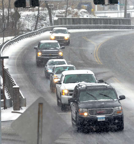 Traffic makes its way along Route 67 at the start of a major snow storm hitting our area today in Seymour, Conn. on Friday February 8, 2013. Photo: Christian Abraham / Connecticut Post