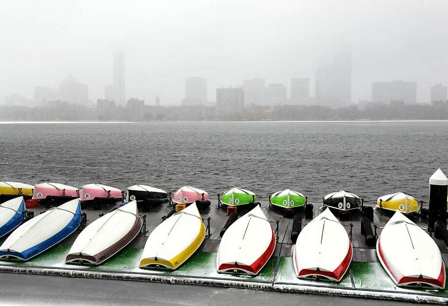 Boats put up for the winter are seen against a snowy Boston skyline on the Charles River  February 8, 2013 in Cambridge, Massachusetts. A coming blizzard is expected to bring heavy snow, high winds and coastal flooding, bringing a halt to public transportation, and airport traffic, beginning this afternoon, and into tomorrow. Photo: Darren McCollester, Getty Images