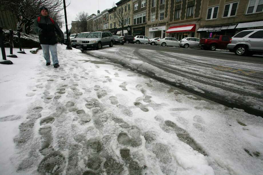 Snow is starting to accumulate on Greenwich Ave as the blizzard approaches Friday, Feb. 8, 2013. Photo: David Ames
