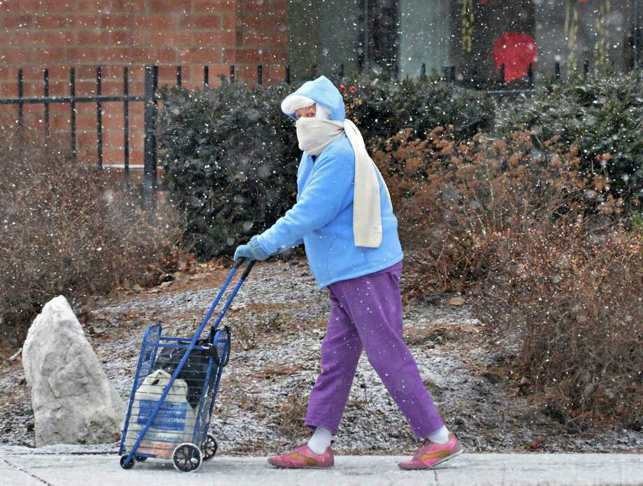 "Watervliet resident Millie Hagaman walks home from ""laying up supplies"" at the supermarket as the snows begin Friday Feb. 8, 2013.  (John Carl D'Annibale / Times Union) Photo: John Carl D'Annibale / 00021096A"